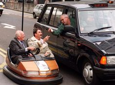 Lord Montagu with former Formula 1 world champion Nigel Mansell during a campaign to promote road safety