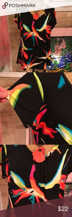 Short capped sleeve top This black polyester top is breathtaking with so many vivid shades of colors. Very festive for summer time activities!! And you will feel great too! Extremely comfortable. NWOT. Worthington Tops Blouses
