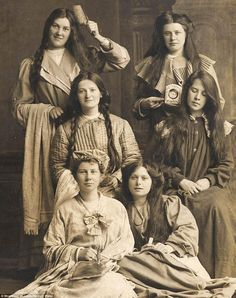 An unknown group of women pose for an undated photograph, with one clearly keen to show of...