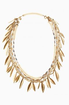 The Garland Fringe Necklace is a versatile piece - wear as a stunning gold leaf necklace, or as a hair necklace. Shop gold leaf necklaces at Stella