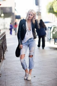 A leather moto jacket teamed with ultra distressed boyfriend jeans is the epitome of biker chic. Since different textures and volumes are at play here, our advice is to stick to a clean color palette.