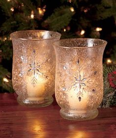 Snowflake Glass Hurricane Candle Holders - These gorgeous candle holders shimmer and glisten with a jeweled, snowflake design.  What a lovely addition to your Christmas decor.