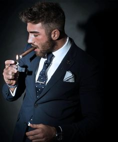 Hair, beard, suit, tie and pocket square. Optional - cigar.