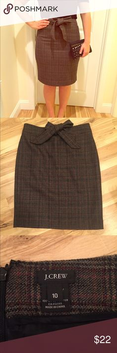 JCrew Bow Front Pencil Skirt Size 10, wool pencil skirt with sewn on bow detail. Plaid pattern of brown, black, and maroon. Zip back, fully lined. New without tags.  Adorable bare legged or with tights and boots! J. Crew Skirts Pencil