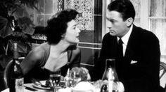 """Harry Street (Gregory Peck): """"Darling, there's a war going on there."""" // Cynthia Green (Ava Gardner): """"There's a war going on here too right at this table! There's a dandy little war going on!"""" -- from The Snows of Kiliminjaro (1952) directed by Henry King"""