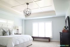 Sherwin Wiliams Sea Salt Paint in a Bright Master Bedroom with Orb Chandelier