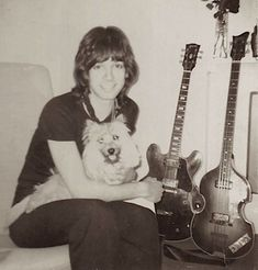 Alan Merrill at home with Popgun the family dog at the Nell Gwynn House, Sloane St. Gibson 340 TD and Hofner bass in the frame. Photo by Yoshiko Mandai. Vodka Collins, Cairn Terrier, Family Dogs, Rock Bands, Puppies, Actors, London England, Guitars, Singers