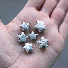 How to make origami stars from strips of newspaper.---i will make these from metal tape and turn them into earrings