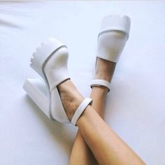 Towering white platform heels featuring a rounded toe and a treaded sole. || Shop the shoes: http://www.nastygal.com/shoes/jeffrey-campbell-scully-platform--white?utm_source=pinterest&utm_medium=smm&utm_term=omg_shoes&utm_campaign=editorial