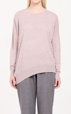A jumper with a twist, this jumper is asymmetrically-designed with a high round neck, dipped side hem and drop shoulders. Pair with a pencil skirt and brogues for a fresh updated look.