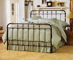 "Boston Bed  This original ""gaslight"" style is one of our oldest designs. Decorative accents are cast by hand directly onto the iron framework. Turned spindles are solid brass castings."