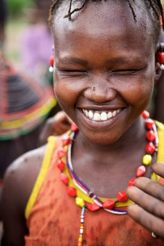 "A week of Faces of the Rift Valley… We regularly ran ""famine feeds"", delivering much needed dry goods deep into the Rift Valley, this time to a place called Riongo. I don't recall what this teenage girl thought was so funny, but she clearly knew something I didn't.   Shot on a Canon EOS 5D and 85mm f/1.2 lens, in April 2007  #RiftValley #Kenya #humanitarian #Riongo #faces #laughter  #Africa #PhotoJosephWeekOfSeries"