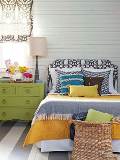 It can't get any better than a fabric covered headboard, painted stripes on the floor and shiplap!
