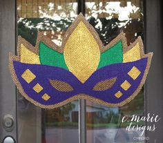 This Door Hanger is perfect for Mardi Gras! It is hand painted on burlap and slightly stuffed to give it some shape. It is stitched together to make a stronger seal and a finished now fray edge. The door hanger can be used indoors or outdoors as it has been treated with a water & UV resistant sealant to protect against direct weather. It comes with an attached wire ready to hang. A SURCHARGE MAY APPLY ON CUSTOM ORDERS. MESSAGE ME FOR FEES BEFORE ORDERING A DIFFERENT DOOR HANGER THAN THE…