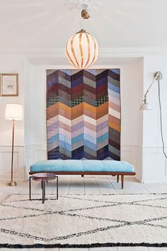 Wall Decoration Idea: Hang Quilts Instead of Canvases. Includes suggestions on how to in the comments.