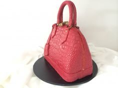 Step by step video instructions to make this Louis Vuitton Hand Bag cake with video, also