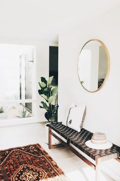 Fiddle leaf fig bohemian home with vintage rug and entryway