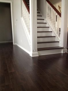 """Espresso wide plank floors were installed throughout my home to replace carpet and bamboo. The rich cool-brown color looks lovely, and the house seems even brighter than before because the dark color reflects so much light."" - Heather, OH"