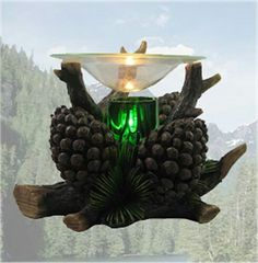 Pine Air Pine Cone Electric Oil Burner < http://blgiftsimports.com/wld31866-wholesale-pine-air-pine-cone-electric-oil-burner-detail.htm >.
