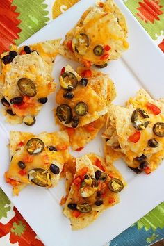 Cheesy Mexican Nacho Stacks. Pop 'em in the oven, place the stacks onto a serving platter, and plop a bit of sour cream on top.