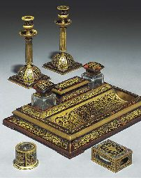 A LATE VICTORIAN OR EDWARDIAN TORTOISESHELL AND BRASS INLAID DESK SET