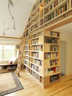 These bookshelves were constructed off site of maple and cherry, and installed when the home was finished.