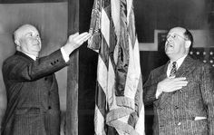 March 29, 1943:  Vierling Kersey, superintendent of schools, left, and Roy J. Becker, Board of Education president, demonstrate old and new methods of saluting Old Glory. The new hand-over-heart method goes in effect in schools on Army Day.  On Dec. 22, 1942, Congress amended the flag code to replace the salute with the hand-over-heart method. The previous salute started with the hand outstretched toward the flag, palm down, and ended with palm up, but it was too similar to salutes used by U.S.