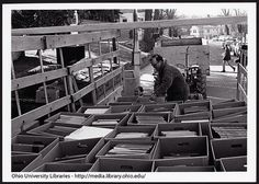 View of books inside hay wagon as Ohio University workers move boxes of books during move from Chubb to Alden Library, ca. 1969.