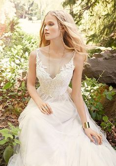 Romantic Ivory / Cashmere English Net A-line bridal gown. Ivory floral lace bodice with a soft illusion V-neckline front and open V-back, natural waist.