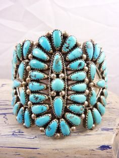 "Large 3 Panel Vintage Navajo ""Zuni-Style"" Sterling Silver and Petit Point Sleeping Beauty Turquoise Squash Blossom Design Cuff Bracelet."