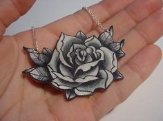 big vintage black and white surreal tattoo rose necklace  (EtsyCyberMonday). $21.00, via Etsy.