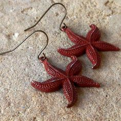 FUN fund  red patina starfish earrings by lluviadesigns on Etsy, $10.00