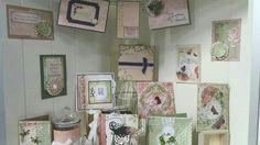 Card display at CHA featuring 3 cards by Amanda Baldwin