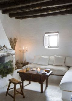 Ethno style guest house mediterranean style fireplace living room