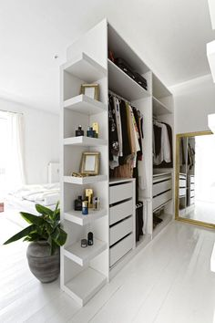 Closet Bedroom Divider - 16 Stylish Wardrobe Ideas That Use The Ikea Pax - - The Ikea pax is one of the most popular wardrobe and closet systems used. Here are 16 of the most stylish wardrobe ideas using the Pax from Ikea. Bedroom Divider, Bedroom Closet Design, Closet Designs, Home Room Design, Bedroom Decor, Ikea Room Divider, Bedroom Furniture, Bedroom Designs, Wardrobe Designs For Bedroom