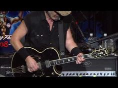 """Ted Nugent - Stranglehold (Motor City Mayhem).  The Nuge shreds on an old Gibson Les Paul Custom that looks like he strapped it to the back of his ATV on too many elk hunts.  I can't like this guy but I can't help but love """"Stranglehold."""""""