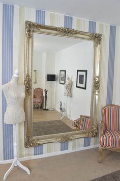 Large Boldly Ornate Wall Mirror is the perfect statement piece for any home. We have added close up pictures of the precision holes around the edge that go through to the front for design and shading. Baroque meets shabby chic frame really draws you in, guaranteed head turner! This particular mirror has a premium bevelled glass size of 6ft x 4ft (183cm x 122cm) and an overall size of 7ft x 5ft (213cm x 152cm).
