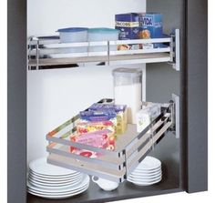 Swiveling Basket »  This swiveling system works well in upper cabinets. It offers accessibility, flexibility and organization by bringing items closer.