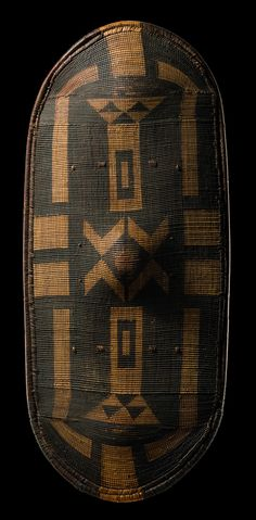 Africa | Shield from the Azande people of DR Congo | Basketry with wooden frame and grip board | ca. late 1800s - early 1900s.