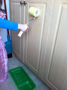 "Paint roller + Paint pan = let children ""paint"" surfaces: good for developing shoulder stability which is needed for fine motor skills"