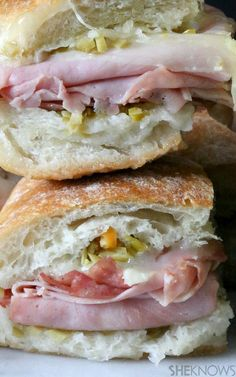 Mini Muffuletta Sandwiches~ a baked mini muffuletta sandwich filled with ham, salami, provolone cheese and a special olive salad and Parmesan cheese dip.