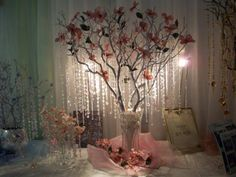 I picture branch decor in vases and sweet little flowers as well