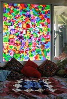 tissue paper window collage..... I put this in sensory because my daughter will LOVE to help tear apart the tissue paper and she'll love all the colors on the window....