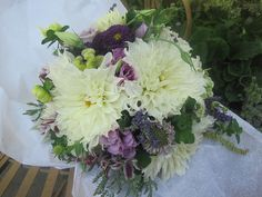 brides bouquet, white Dahlias, lavender roses, asters, lavender spikes, scented geranium