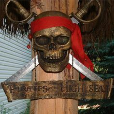 """This is our fastest moving decoration for our tiki bars. It is a Pirates of the High Seas Sword Set. The swords are real and removable. They measure 16 1/2"""" overall length. The skull is a cast resin and the sign is metal. This is perfect for the Pirate themed Tiki bar or Tiki Hut, or for any room in the house."""