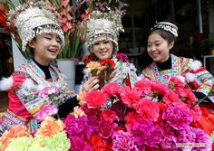 Young ladies of the Miao ethnic group select flowers for the coming Spring Festival in Rongshui County, Guangxi Zhuang Autonomous Region, Feb. 8, 2013. The Spring Festival, the most important occasion for the family reunion for the Chinese people, falls on the first day of the first month of the traditional Chinese lunar calendar, or Feb. 10 this year.