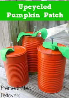 Rustic Tin Can Pumpkins - An Upcycled DIY Project - These easy tin can pumpkins are made with recycled tin cans, screws, and a little bit of spray paint.