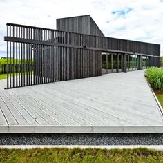 Open AD interprets a form of the Japanese garden and places this private house at the center of the plot/ Set in Marupe, Latvia, the house features a wrap-around deck ideal for taking in the surrounding landscape