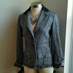 CABI.......STUNNING BLAZER....COAT. ....EXCELLENT CONDITION  ....LIKE NEW ....NO FLAWS ....STUNNING  ....true to its size and color. ....color... gray / black ....2 pic up close ....size 2 ...fit's size 4 ..as well ....bronze buttons. ....2 button on front ....button down  ....2 front pockets  ....V...neck collar  ... back design / buttons ....MTRL.88%wool 11%nylon 1%spandex  ....LINING..100%polyester  ....LAPEL..47%wool 40%polyester 4%rayon 3%nylon ....better in person CAbi Jackets & Coats…