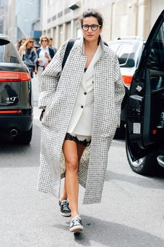 I like the contrast of the oversized winter coat with the skirt and trainers #streetstyle